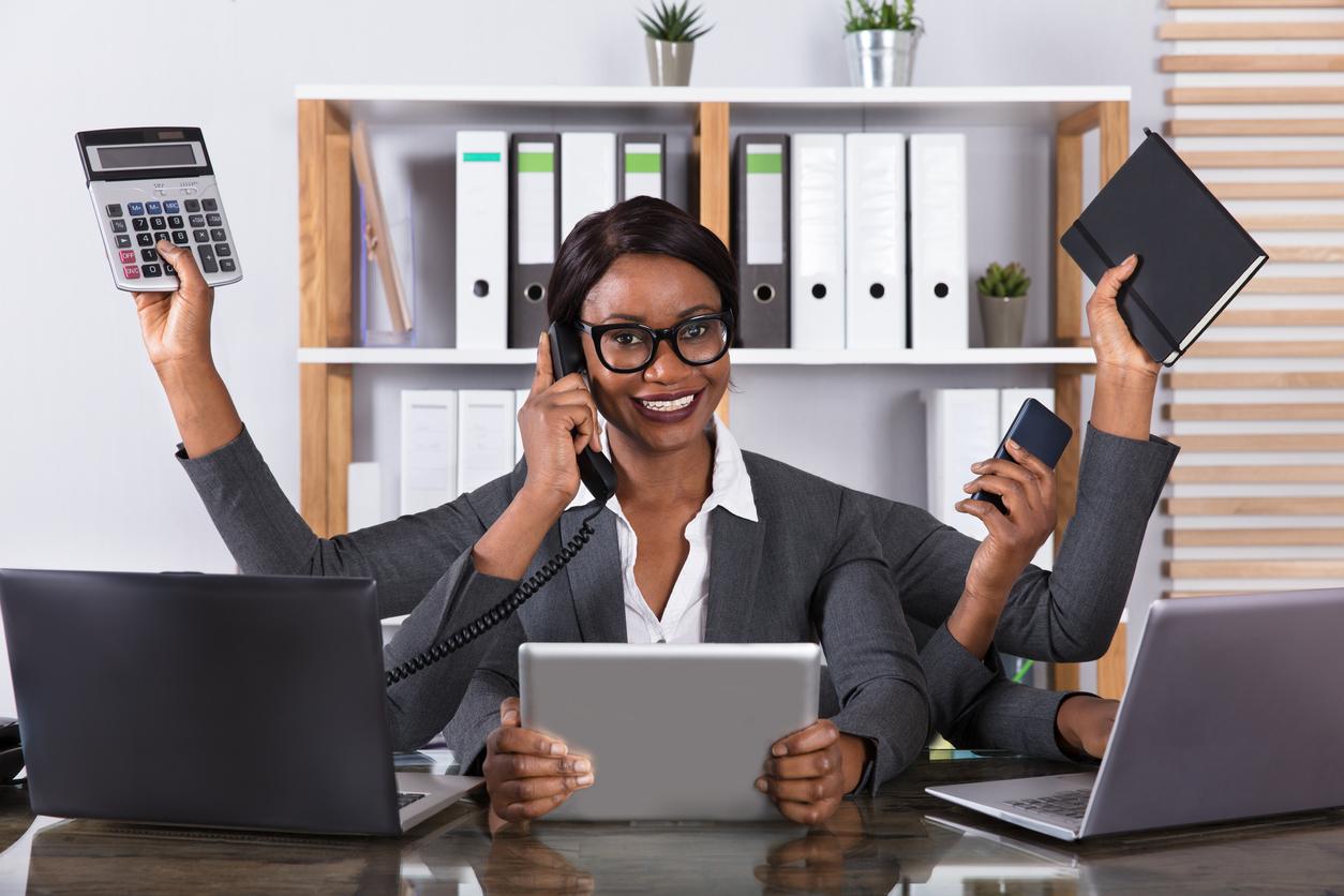 Woman Doing Multitasking Work On Laptop